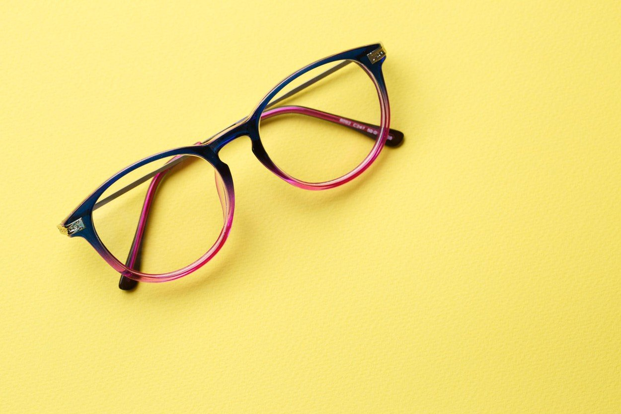 Blue-pink glasses with clear lenses on yellow background empty, Image: 307542477, License: Royalty-free, Restrictions: , Model Release: no, Credit line: Profimedia, Alamy