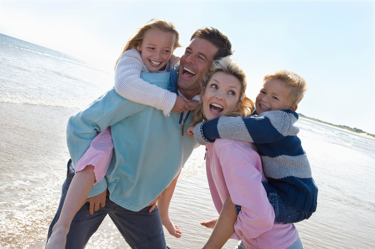 Young happy family at beach, Image: 12804942, License: Royalty-free, Restrictions: , Model Release: yes, Credit line: Profimedia, Juice Images